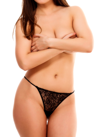 topless brunette: Woman covers her breast by hands, isolated on white background