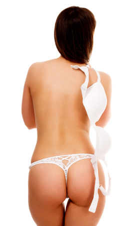 femmes nues sexy: Déshabillage femme, isolé sur fond blanc