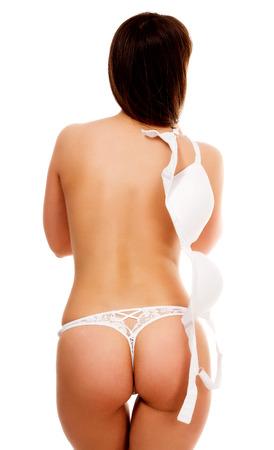 naked sexy women: Undressing woman, isolated on white background Stock Photo