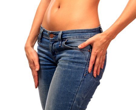 Woman in blue jeans, isolated on white