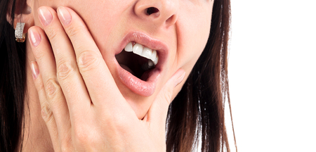 Woman with a toothpain, isolated on a white background