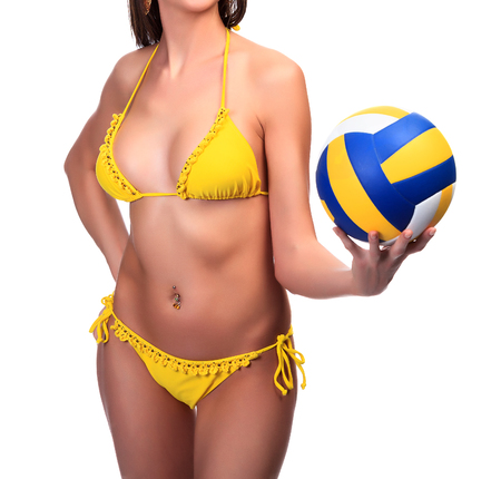 yellow bikini: Sexy woman in yellow bikini holds a ball, isolated on a white background Stock Photo
