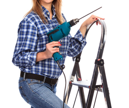 drill: Woman holds a drill, isolated on a white background