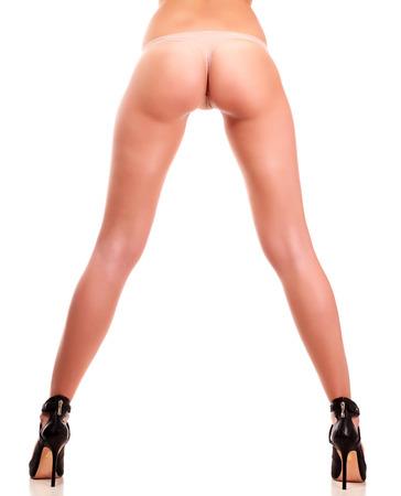 donna nuda: Lunghe gambe bella donna, isolato su sfondo bianco