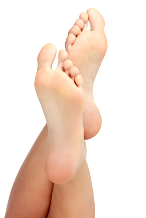 Female bare feet on white background Stock Photo