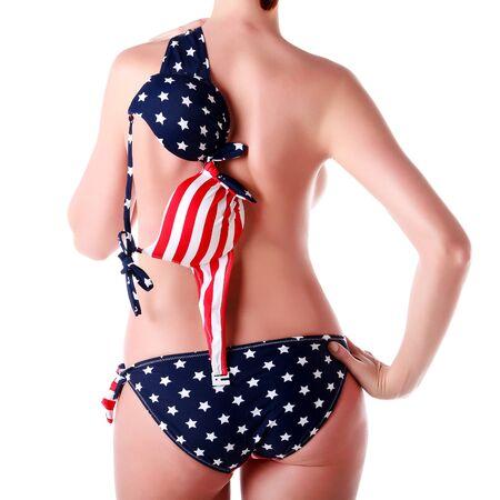 grosse fesse: Femme en bikini avec impression drapeau USA, isolé sur fond blanc Banque d'images