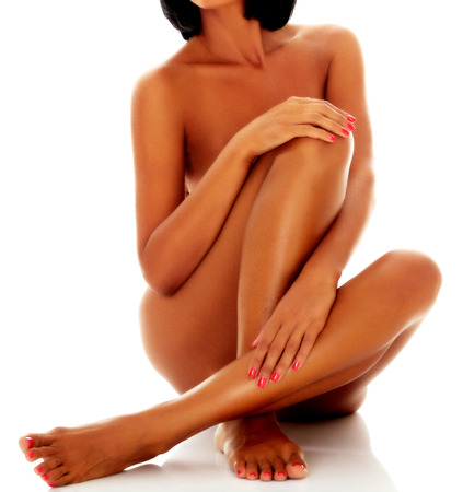 feet naked: Naked woman sit on white background