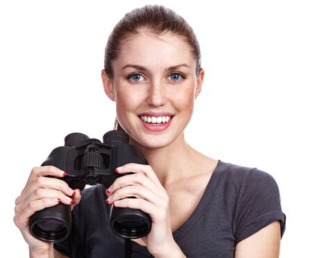 Happy young woman with binoculars, isolated on white background photo