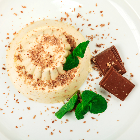 blancmange: Blancmange with chocolate on glass plate