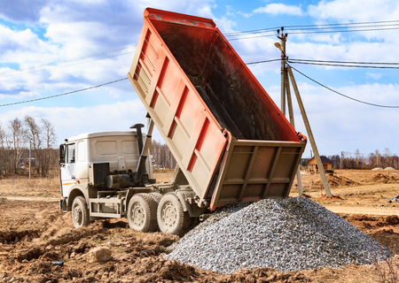 gravel: Dumptruck in action on a construction site
