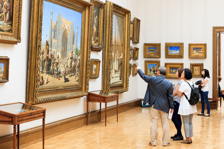 MOSCOW, RUSSIA - JUNE 21, 2016: Visitors in the State Tretyakov Gallery in Moscow, Russia, the foremost depository of Russian fine art in the world.