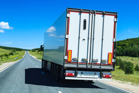moving truck: Picture of big truck with the trailer moves on the highway