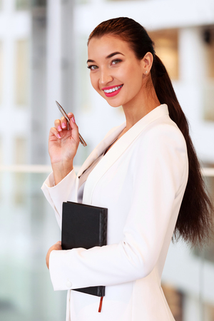 education: Smiling woman in an office