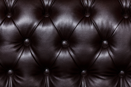 Closeup shot of dark brown leather texture with buttons. Furniture texture  Stock Photo