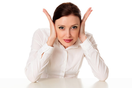Pretty business woman closing her ears, isolated on white background