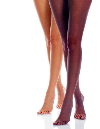 Long woman legs of black and caucasian girls isolated on white background Stock Photo