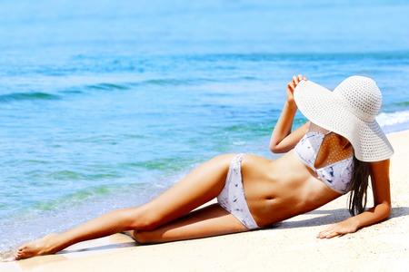 Slim woman on a beach. Summer holidays Stock Photo