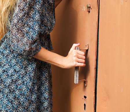 Woman holding doorknob, closeup shot Foto de archivo