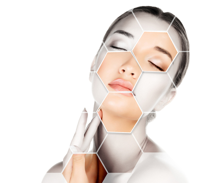 Pretty woman is touching her face, skin treatment concept.  Stock Photo
