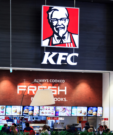 Kentucky Fried Chicken (KFC) Sign. KFC is a fast food restaurant chain that specializes in fried chicken Editorial