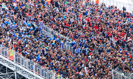 YEKATERINBURG, Russia June 15, 2018: Fans are sitting and watching football, stadium Yekaterinburg Arena, made for the World Cup in Russia. Match between Uruguay and Egypt 新聞圖片