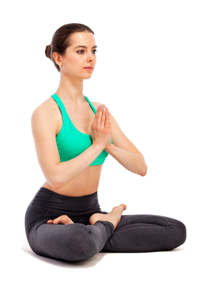Yoga woman posing on white background, isolated