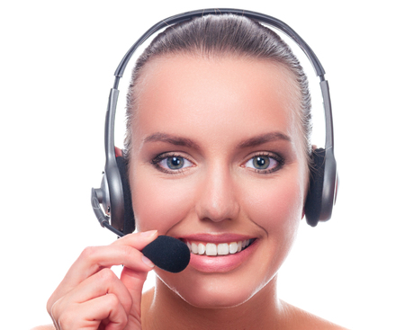 Closeup shot portrait of young pretty woman with headset isolated on white background Imagens