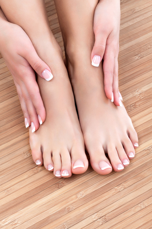 Closeup shot of beautiful female feet and hands. Skin care concept