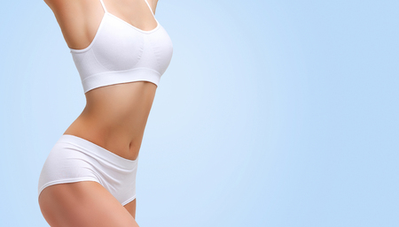 Closeup shot of beautiful female body. Liposuction, diet and healthy lifestyle, weight loss concept