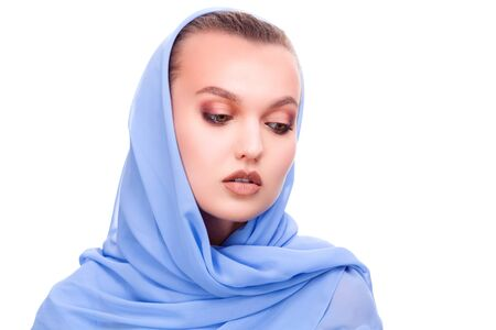 Pretty woman in blue shawl isolated on white background