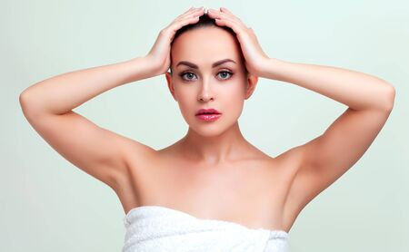 Beauty portrait of young woman in towel after shower