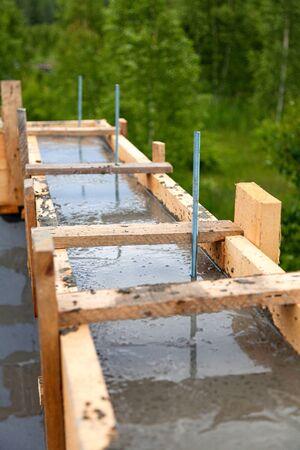 Wooden formwork concrete strip foundation for a new house Standard-Bild