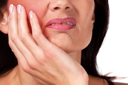 Beautiful woman suffering from toothache, closeup shot, white background