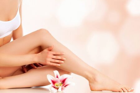 Young beautiful woman with gorgeous slim body and lily flower