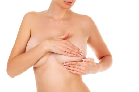 Woman controlling her breast for cancer, isolated on white background Banque d'images