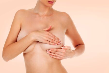 Woman controlling her breast for cancer