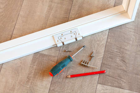 Hinge on the white door frame Stock Photo