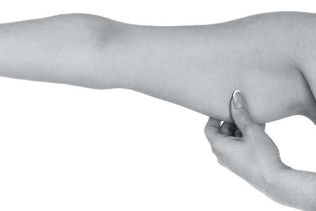Woman holding her hand with excess fat, isolated on a white background