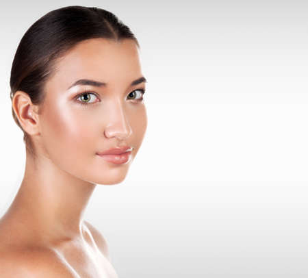 Portrait of pretty woman against a grey background with copyspace, ,skin care concept Stock Photo