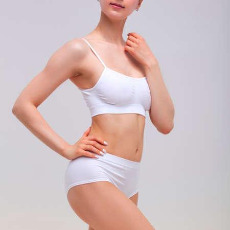 Beautiful slim woman in white lingerie Stock fotó