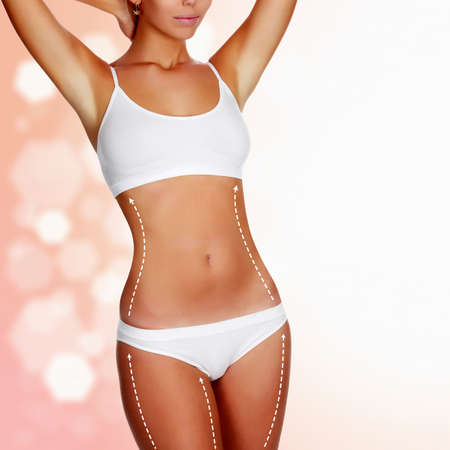 Dotted lines on beautiful female body. Closeup of woman slim fit body with white marks