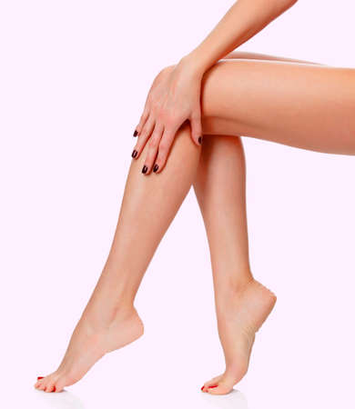 Female legs on pink background Stock Photo