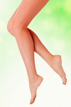 Legs in the air, green blurred background