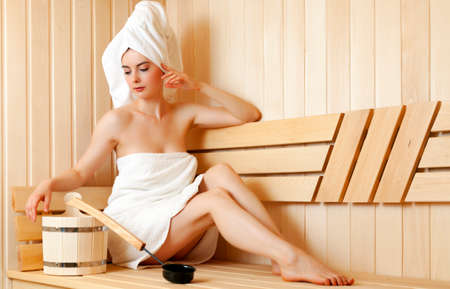 woman relaxing in sauna Stock Photo