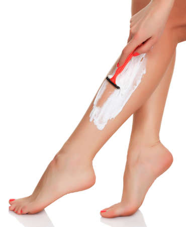 woman shaves her legs, isolated on white, copyspace