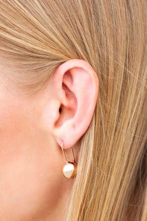 Closeup shot of female ear with earring
