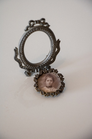 miniature mirror frame with photo medallion of steampunk young woman