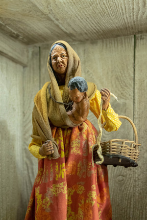 Santon de Provence (traditional figurine from the south of France for Christmas), woman and child, work of a midwife, cut-out object 写真素材