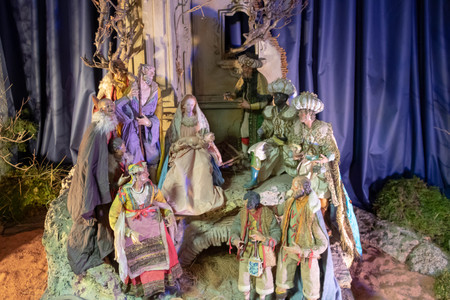 Staging an old Christmas crib with santons of Provence (traditional figurine from southern France for Christmas cribs)