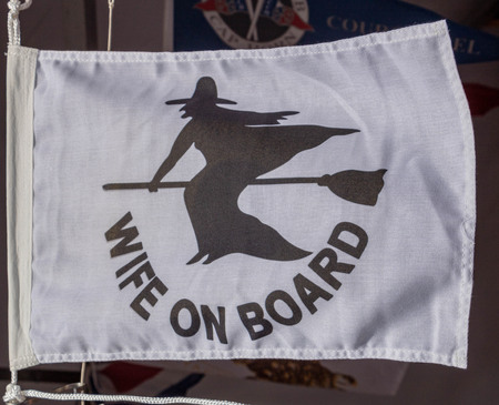 flag representing a woman aboard a boat
